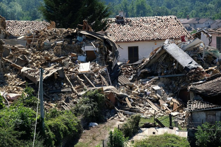 Damaged houses are pictured in Casale, a central Italian village near Amatrice on August 26, 2016, two day after a 6.2-magnitude earthquake struck the region killing some 267 people. An increasingly forlorn search for victims of the earthquake that brought carnage to central Italy entered a third day on August 26, 2016 as a day of mourning was declared for victims of a disaster that has claimed at least 267 lives. Releasing the new confirmed death toll, Immacolata Postiglione, head of the Civil Protection agency's emergency unit, indicated there had been no survivors found overnight in any of the remote mountain villages devastated by August 24's powerful pre-dawn quake. At least 367 people have been hospitalised with injuries but no one has been pulled alive from the piles of collapsed masonry since August 24 evening. (Mario Laporta/AFP/Getty Images)