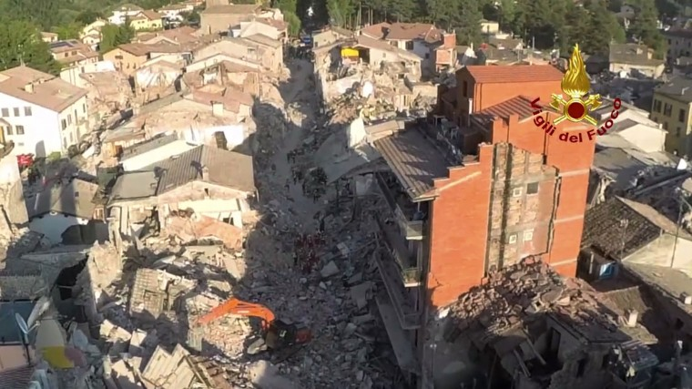 A handout image grab taken and released by the Vigili del fuoco (Italian Firefighters) press office on August 26, 2016 shows an aerial view of the central street of Amatrice in central Italy, two day after a 6,2 magnitude earthquake that struck the region killing some 267 people. Italy on August 26, 2016 declared a day of mourning for victims of a devastating earthquake as hopes of finding any more survivors dwindled and the confirmed death toll rose to 267. Flags will fly at half-mast across the country on August 27 to coincide with funerals for some of the victims. Immacolata Postiglione, head of the Civil Protection agency's emergency unit, said no new survivors had been found overnight in the remote mountain villages blitzed by Wednesday's powerful pre-dawn quake. (Vigili del Fuoco/AFP/Getty Images)