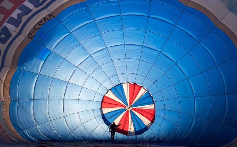 Hot air balloons are prepared to take to the skies at a preview flight to launch next week's Bristol International Balloon Fiesta on August 5, 2016 in Bristol, England. The four day event event, which will officially open next week on Thursday, is now in its 38th year and is Europe's largest annual hot air balloon event in the city that is seen as many as the home of modern ballooning. (Photo by Matt Cardy/Getty Images)