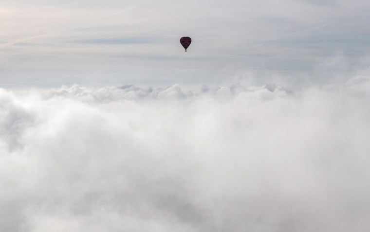Hot air balloons fly into mist and cloud at a preview flight to launch next week's Bristol International Balloon Fiesta on August 5, 2016 in Bristol, England. The four day event event, which will officially open next week on Thursday, is now in its 38th year and is Europe's largest annual hot air balloon event in the city that is seen as many as the home of modern ballooning. (Photo by Matt Cardy/Getty Images)