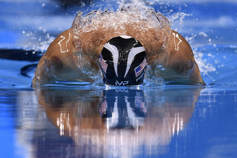 USA's Michael Phelps competes in the Men's 200m Individual Medley Semifinal during the swimming event at the Rio 2016 Olympic Games at the Olympic Aquatics Stadium in Rio de Janeiro on August 10, 2016. (Martin Bureau/AFP/Getty Images)