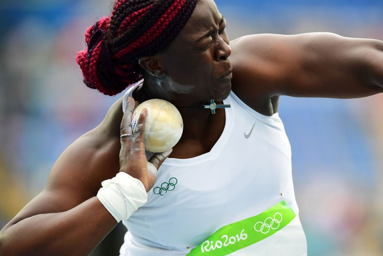 Cameroon's Auriol Dongmo competes in the Women's Shot Put Qualifying Round during the athletics event at the Rio 2016 Olympic Games at the Olympic Stadium in Rio de Janeiro on August 12, 2016. / (AFP Photo/Franck Fife)