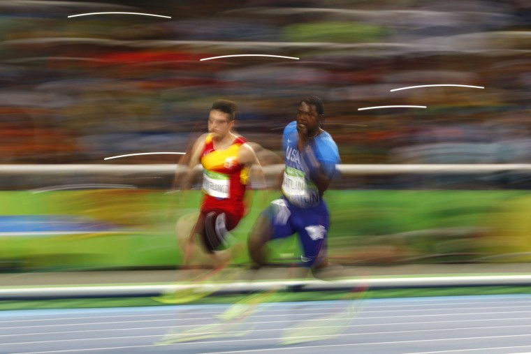 (L-R) Spain's Bruno Hortelano and USA's Justin Gatlin compete in the Men's 200m Semifinal during the athletics event at the Rio 2016 Olympic Games at the Olympic Stadium in Rio de Janeiro on August 17, 2016. (Adrian Dennis/AFP/Getty Images)