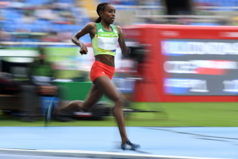 Ethiopia's Almaz Ayana competes in the Women's 10,000m during the athletics event at the Rio 2016 Olympic Games at the Olympic Stadium in Rio de Janeiro on August 12, 2016. / (AFP Photo/Jewel Samad)