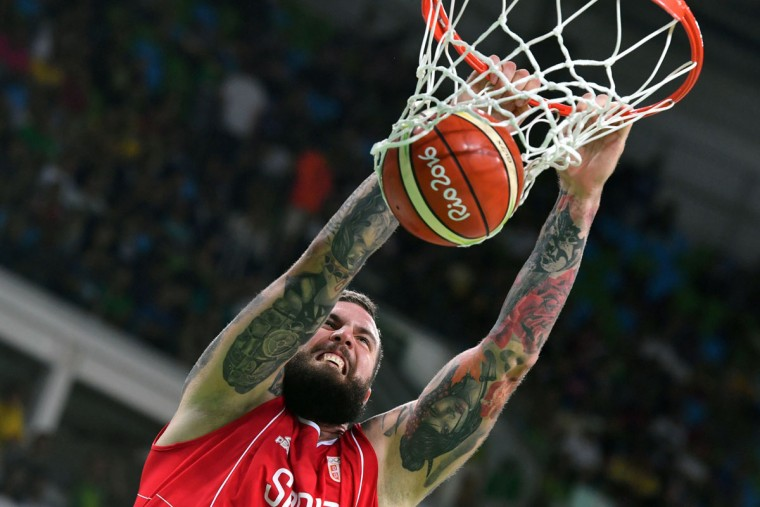 Serbia's centre Miroslav Raduljica scores during a Men's round Group A basketball match between Venezuela and Serbia at the Carioca Arena 1 in Rio de Janeiro on August 6, 2016 during the Rio 2016 Olympic Games. (AFP PHOTO / Andrej ISAKOVIC)