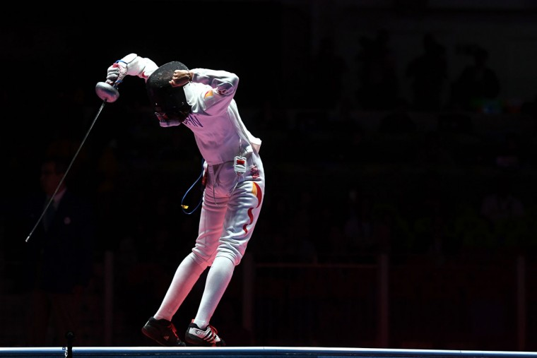 China's Sun Yiwen celebrate winning against France's Lauren Rembi in the womens individual epee bronze medal bout as part of the fencing event of the Rio 2016 Olympic Games, on August 6, 2016, at the Carioca Arena 3, in Rio de Janeiro. (AFP PHOTO / Kirill KUDRYAVTSEV)