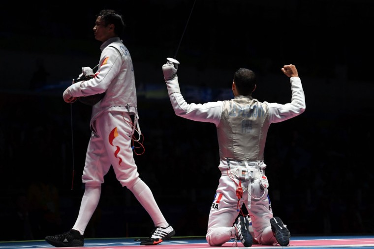 France's Erwan le Pechoux (R) celebrates winning the mens team foil quarter-final bout between China and France as part of the fencing event of the Rio 2016 Olympic Games, on August 12, 2016, at the Carioca Arena 3, in Rio de Janeiro. / (AFP Photo/Kirill Kudryavtsev)