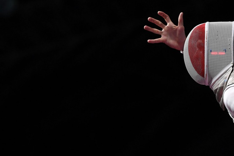 France's Jeremy Cadot reacts during the mens team foil quarter-final bout between China and France as part of the fencing event of the Rio 2016 Olympic Games, on August 12, 2016, at the Carioca Arena 3, in Rio de Janeiro. / (AFP Photo/Kirill Kudryavtsev)