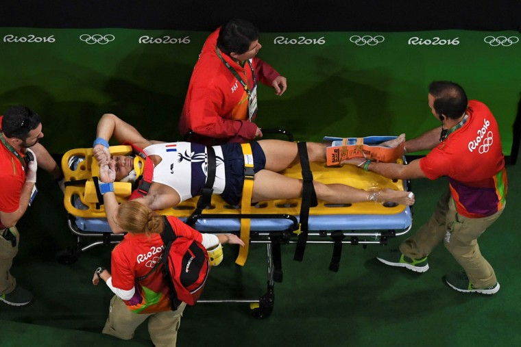 An overview shows France's Samir Ait Said being stretchered off after being injured while competing in the qualifying for the men's vault event of the Artistic Gymnastics at the Olympic Arena during the Rio 2016 Olympic Games in Rio de Janeiro on August 6, 2016. (AFP PHOTO / Antonin THUILLIER)