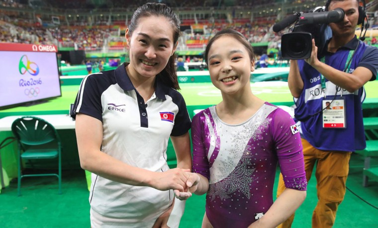 This picture taken on August 7, 2016 shows South Korean gymnast Lee Eun-Ju (C) and North Korea's Hong Un-Jong (L) posing for a photo after their competition during the women's qualification for the artistic gymnastics at the Rio 2016 Olympic Games at the Rio Olympic Arena in Rio de Janeiro.South Korean gymnast Lee Eun-Ju, who found herself in the international spotlight after taking a selfie with a North Korean competitor in Rio, said on August 12 she was surprised by the extraordinary response to such a simple act. / (AFP Photo/Yonhap / )