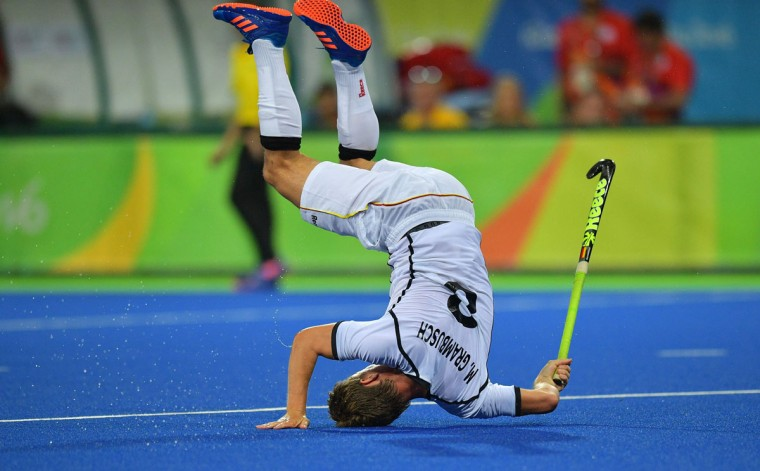 Germany's Mats Grambusch falls during the men's field hockey Canada vs Germany match of the Rio 2016 Olympics Games at the Olympic Hockey Centre in Rio de Janeiro on August, 6 2016. (AFP PHOTO / Carl DE SOUZA)