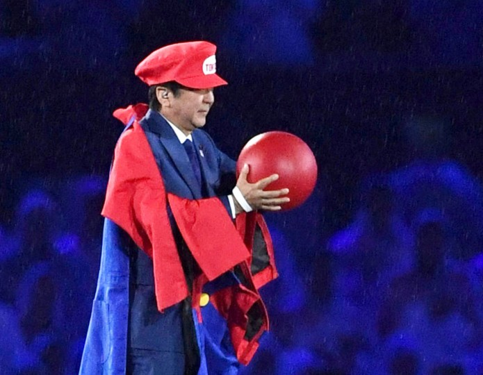 In this Sunday, Aug. 21, 2016, file photo, Japanese Prime Minister Shinzo Abe appears as the Nintendo game character Super Mario during the closing ceremony at the 2016 Summer Olympics in Rio de Janeiro, Brazil. Abe's brief but show-stopping appearance as Super Mario offered a glimpse at Tokyo's plans for the 2020 games. (Yu Nakajima/Kyodo News via AP, File)