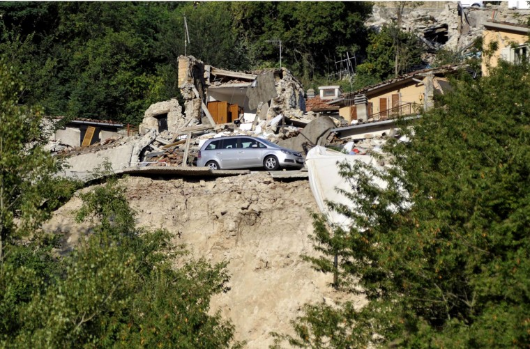 A car is parked next to a collapsed house in Pescara del Tronto, central Italy, Friday, Aug. 26, 2016, two days after an earthquake. Strong aftershocks rattled residents and rescue crews alike Friday as hopes began to dim that rescuers would find any more survivors from Italy's earthquake. (Cristiano Chiodi/ANSA via AP)