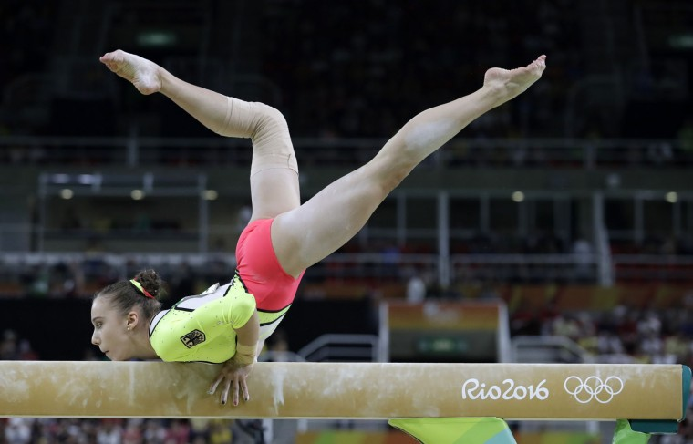 Germany's Tabea Alt performs on the balance beam during the artistic gymnastics women's team final at the 2016 Summer Olympics in Rio de Janeiro, Brazil, Tuesday, Aug. 9, 2016. (AP Photo/Rebecca Blackwell)