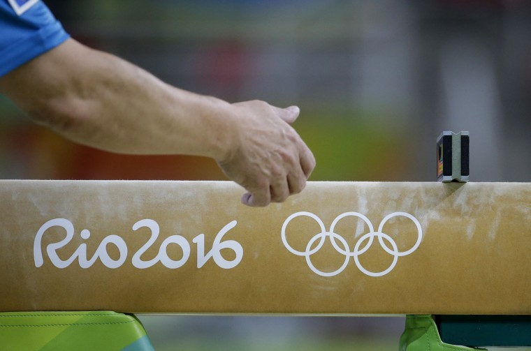 Workers place a spirit level on the beam ahead of the artistic gymnastics women's team final at the 2016 Summer Olympics in Rio de Janeiro, Brazil, Tuesday, Aug. 9, 2016. (AP Photo/Rebecca Blackwell)