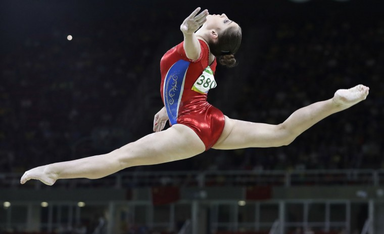 Russia's Aliya Mustafina performs on the balance beam during the artistic gymnastics women's team final at the 2016 Summer Olympics in Rio de Janeiro, Brazil, Tuesday, Aug. 9, 2016. (AP Photo/Rebecca Blackwell)