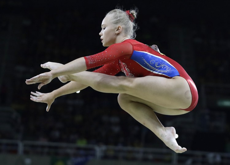 Russia's Angelina Melnikova performs on the balance beam during the artistic gymnastics women's team final at the 2016 Summer Olympics in Rio de Janeiro, Brazil, Tuesday, Aug. 9, 2016. (AP Photo/Rebecca Blackwell)