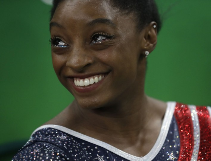 United States' Simone Biles rests in between performances during the artistic gymnastics women's team final at the 2016 Summer Olympics in Rio de Janeiro, Brazil, Tuesday, Aug. 9, 2016. (AP Photo/Julio Cortez)