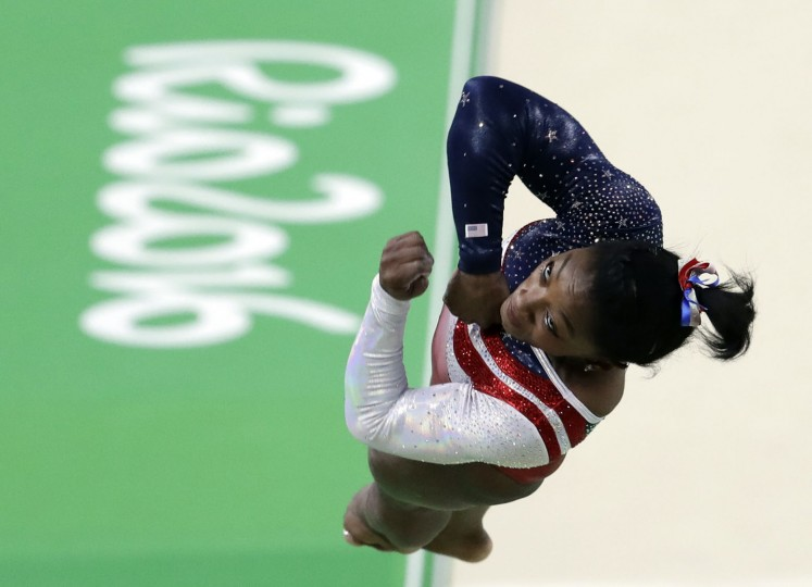 United States' Simone Biles performs on the vault during the artistic gymnastics women's team final at the 2016 Summer Olympics in Rio de Janeiro, Brazil, Tuesday, Aug. 9, 2016. (AP Photo/Dmitri Lovetsky)
