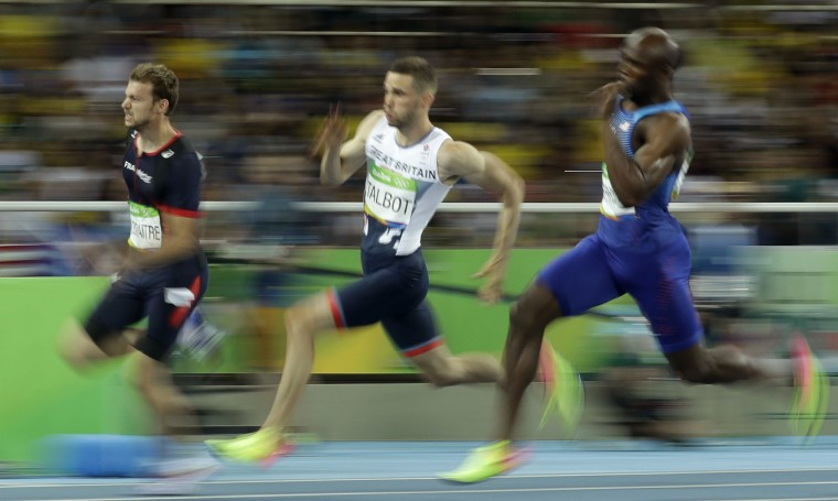 France's Christophe Lemaitre, Britain's Daniel Talbot and United States' Lashawn Merritt, from left, men's 200-meter semifinal during the athletics competitions of the 2016 Summer Olympics at the Olympic stadium in Rio de Janeiro, Brazil, Wednesday, Aug. 17, 2016. (AP Photo/Matt Dunham)