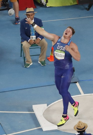 United States' Ryan Crouser competes in the shot put finals during the athletics competitions of the 2016 Summer Olympics at the Olympic stadium in Rio de Janeiro, Brazil, Thursday, Aug. 18, 2016. (AP Photo/Morry Gash)