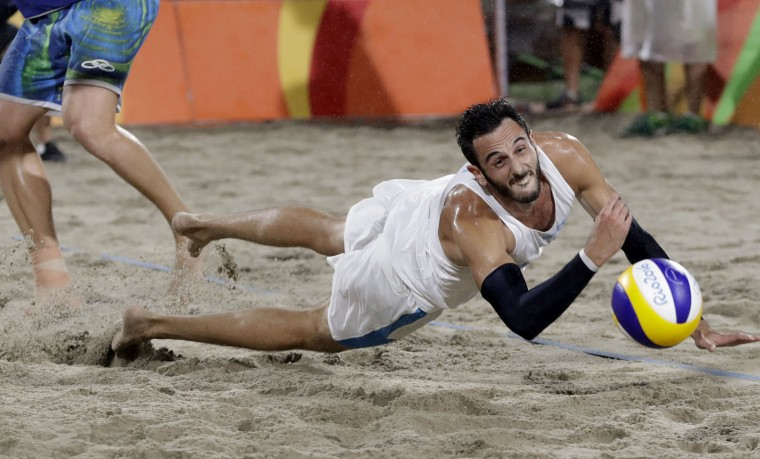 Italy's Paolo Nicolai can't reach a ball while playing against Brazil during the men's beach volleyball gold medal match at the 2016 Summer Olympics in Rio de Janeiro, Brazil, Friday, Aug. 19, 2016. (AP Photo/Petr David Josek)