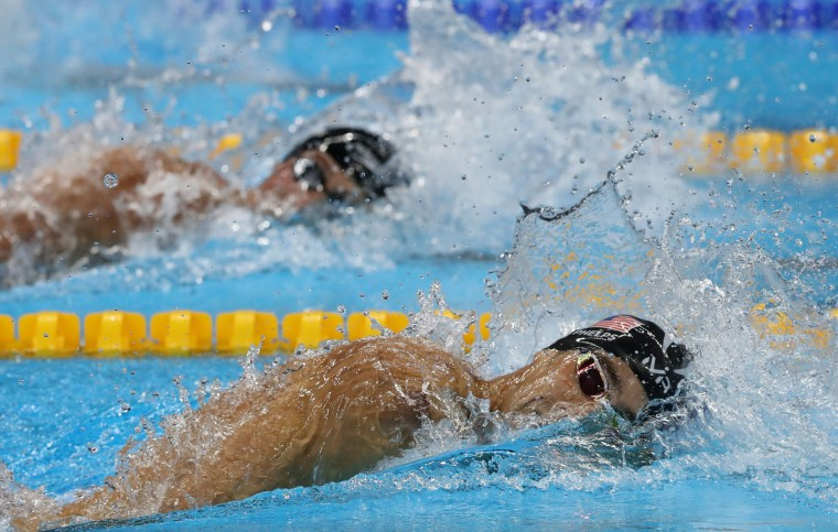 United States' Michael Phelps and United States' Ryan Lochte, left, compete in a semifinal of the men's 200-meter individual medley during the swimming competitions at the 2016 Summer Olympics, Wednesday, Aug. 10, 2016, in Rio de Janeiro, Brazil. (AP Photo/Lee Jin-man)