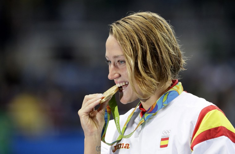 Spain's Mireia Belmonte Garcia celebrates winning the gold medal in the women's 200-meter butterfly during the swimming competitions at the 2016 Summer Olympics, Wednesday, Aug. 10, 2016, in Rio de Janeiro, Brazil. (AP Photo/David J. Phillip)