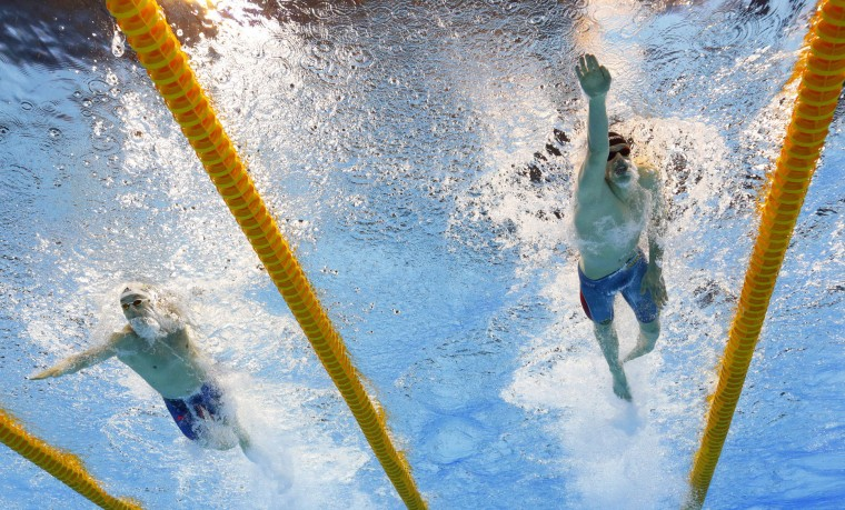 Germany's Philip Heintz, right, and Brazil's Henrique Rodrigues compete in a semifinal of the men's 200-meter individual medley during the swimming competitions at the 2016 Summer Olympics in Rio de Janeiro, Brazil, Wednesday, Aug. 10, 2016. (AP Photo/David J. Phillip)