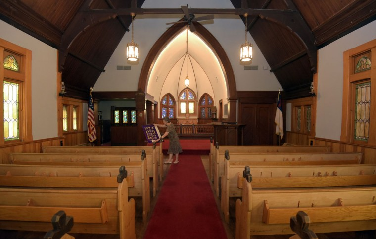 """Nancy Cook, chair of the Historic Stevensville Arts & Entertainment District, and chair of the Historic Sites consortium of Queen Anne's County, is pictured inside Christ Church and Rectory built in 1880 in Stevensville. According to the Kent Island Heritage Society, Inc., it is """"the fifth church of this Christ Church parish founded in 1631, and is the oldest continuous Episcopal congregation in the United States."""" Along with other historical sites in Stevensville, the church is open the first Saturdays of the month from May to October. (Algerina Perna/Baltimore Sun)"""