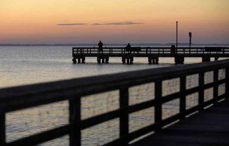 Fishermen fish shortly before sunrise at Romancoke Pier on Kent Island. (Algerina Perna/Baltimore Sun)