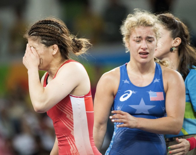 United States' Helen Louise Maroulis, right, walks away after defeating Japan's Saori Yoshida for the gold in the women's wrestling freestyle 53-kg competition at the 2016 Summer Olympics in Rio de Janeiro, Brazil, Thursday, Aug. 18, 2016. (Ryan Remiorz/The Canadian Press via AP)