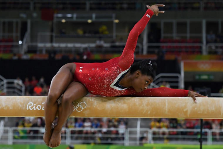 US gymnast Simone Biles competes in the women's balance beam event final of the Artistic Gymnastics at the Olympic Arena during the Rio 2016 Olympic Games in Rio de Janeiro on August 15, 2016. (TOSHIFUMI KITAMURA/AFP/Getty Images)