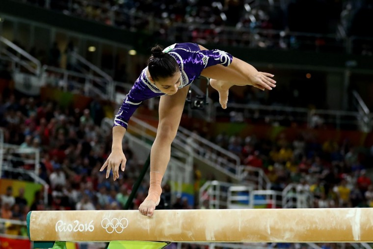 Flavia Saraiva of Brazil slips while competing in the Balance Beam Final on day 10 of the Rio 2016 Olympic Games at Rio Olympic Arena on August 15, 2016 in Rio de Janeiro, Brazil. (Photo by Lars Baron/Getty Images)