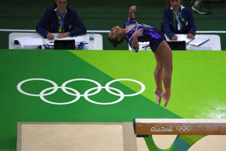 An overview shows Brazil's Flavia Saraiva competing in the women's balance beam event final of the Artistic Gymnastics at the Olympic Arena during the Rio 2016 Olympic Games in Rio de Janeiro on August 15, 2016. (TOSHIFUMI KITAMURA/AFP/Getty Images)