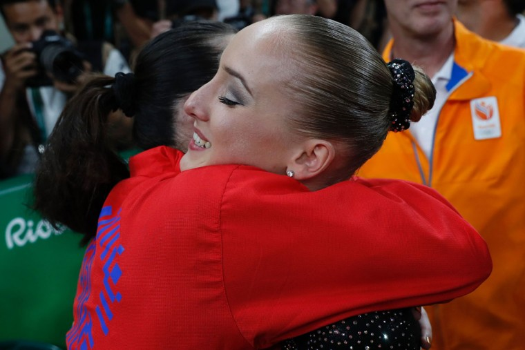 Netherlands' Sanne Wevers (right) celebrates with US gymnast Lauren Hernandez after winning the women's balance beam event final of the Artistic Gymnastics at the Olympic Arena during the Rio 2016 Olympic Games in Rio de Janeiro on August 15, 2016. (THOMAS COEX/AFP/Getty Images)