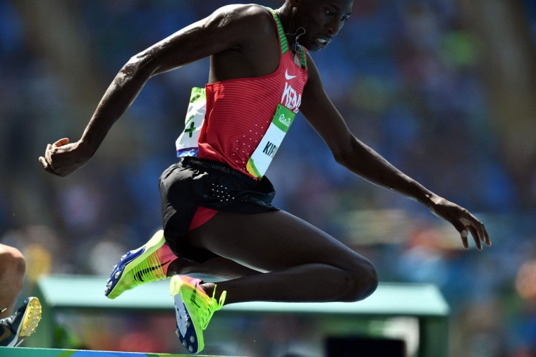 Kenya's Conseslus Kipruto competes in the Men's 3000m Steeplechase Final during the athletics event at the Rio 2016 Olympic Games at the Olympic Stadium in Rio de Janeiro on August 17, 2016. (JEWEL SAMAD/AFP/Getty Images)