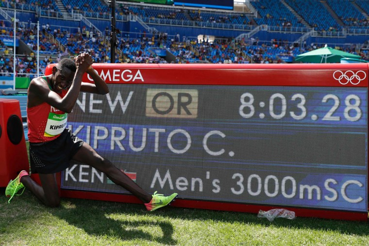 Kenya's Conseslus Kipruto celebrates after setting a new Olympic record and winning the Men's 3000m Steeplechase Final during the athletics event at the Rio 2016 Olympic Games at the Olympic Stadium in Rio de Janeiro on August 17, 2016. (ADRIAN DENNIS/AFP/Getty Images)