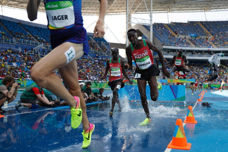 Kenya's Ezekiel Kemboi and Kenya's Conseslus Kipruto (right) compete in the Men's 3000m Steeplechase Final during the athletics event at the Rio 2016 Olympic Games at the Olympic Stadium in Rio de Janeiro on August 17, 2016. (ADRIAN DENNIS/AFP/Getty Images)