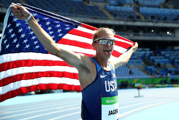 Evan Jager of the United States celebrates with the American flag after winning the silver medal in the Men's 3000m Steeplechase Final on Day 12 of the Rio 2016 Olympic Games at the Olympic Stadium on August 17, 2016 in Rio de Janeiro, Brazil. (Photo by Cameron Spencer/Getty Images)