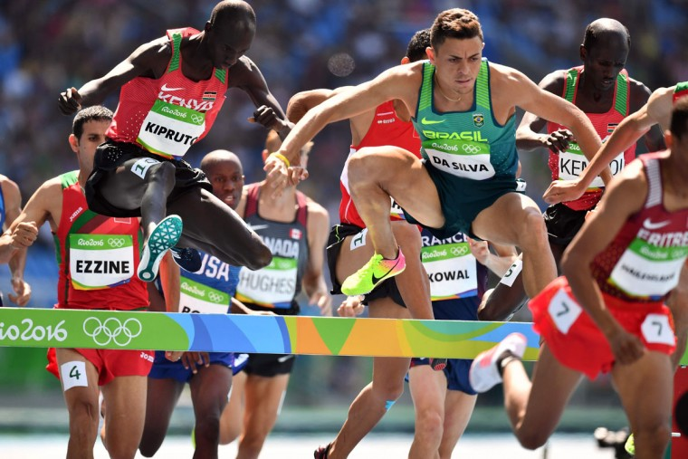Kenya's Brimin Kipruto (left) and Brazil's Altobeli Silva compete in the Men's 3000m Steeplechase Final during the athletics event at the Rio 2016 Olympic Games at the Olympic Stadium in Rio de Janeiro on August 17, 2016. (JEWEL SAMAD/AFP/Getty Images)