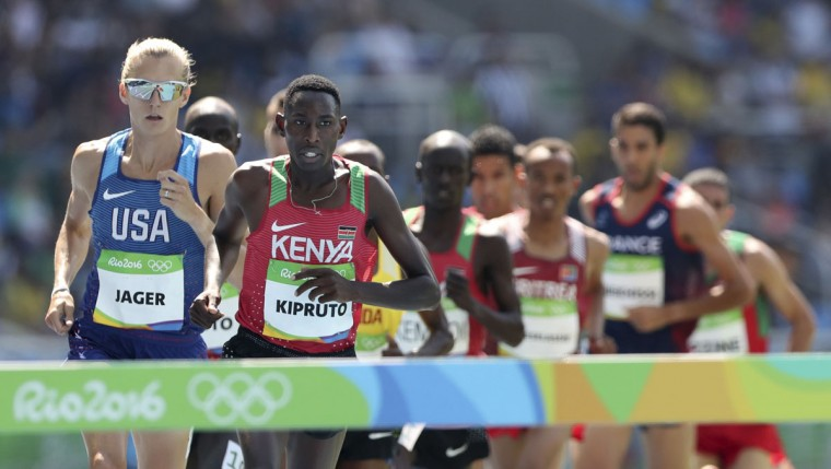 United States' Evan Jager leads Kenya's Conseslus Kipruto in the men's 3000-meter steeplechase final during the athletics competitions of the 2016 Summer Olympics at the Olympic stadium in Rio de Janeiro, Brazil, Wednesday, Aug. 17, 2016. (AP Photo/Lee Jin-man)