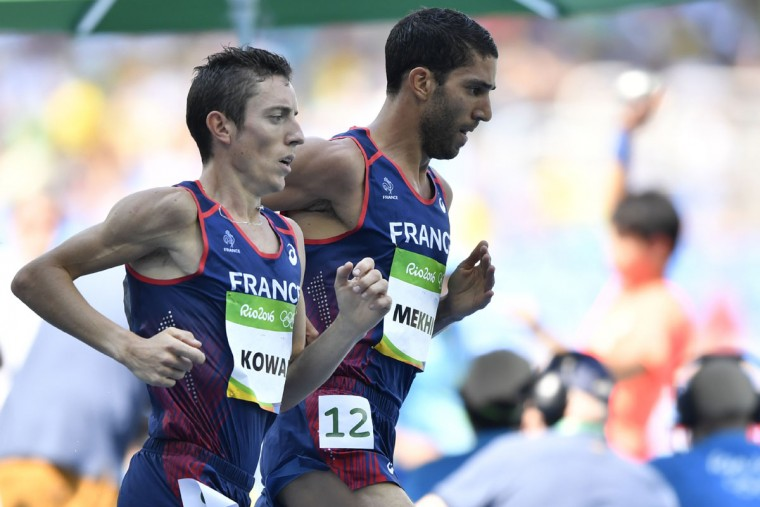 France's Yoann Kowal (left) and France's Mahiedine Mekhissi compete in the Men's 3000m Steeplechase Final during the athletics event at the Rio 2016 Olympic Games at the Olympic Stadium in Rio de Janeiro on August 17, 2016. (FABRICE COFFRINI/AFP/Getty Images)