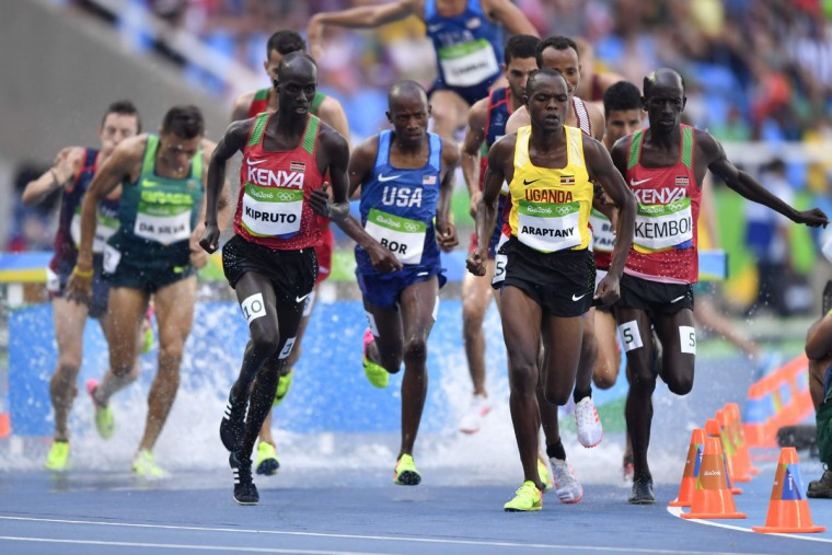 From left, Kenya's Brimin Kipruto, USA's Hillary Bor, Uganda's Jacob Araptany and Kenya's Ezekiel Kemboi compete in the Men's 3000m Steeplechase Final during the athletics event at the Rio 2016 Olympic Games at the Olympic Stadium in Rio de Janeiro on August 17, 2016. (FABRICE COFFRINI/AFP/Getty Images)
