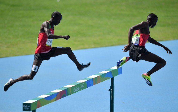 Kenya's Ezekiel Kemboi (left) and Kenya's Conseslus Kipruto compete in the Men's 3000m Steeplechase Final during the athletics event at the Rio 2016 Olympic Games at the Olympic Stadium in Rio de Janeiro on August 17, 2016. (PEDRO UGARTE/AFP/Getty Images)
