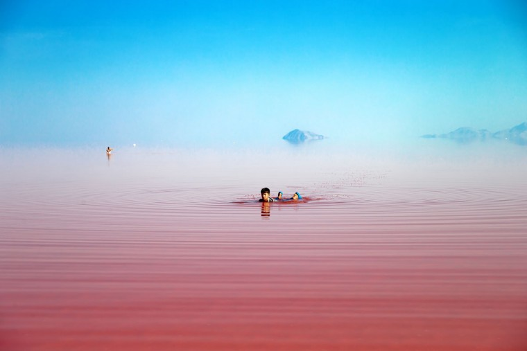 This picture taken on Friday, Aug. 26, 2016, shows an Iranian swimming in Urmia Lake near Urmia, northwestern Iran. Hopes for survival of Urmia salt lake have been revived after more rains boosted a government program aimed at preserving the almost dried up water body. (AP Photo/Ebrahim Noroozi)