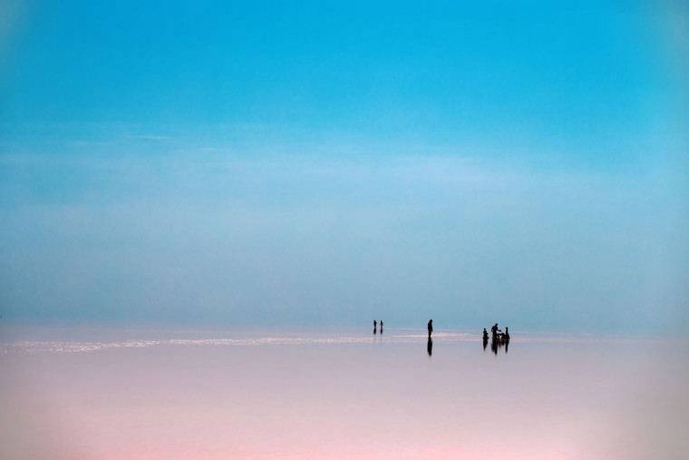 This picture taken on Friday, Aug. 26, 2016, shows Iranians spending time in Urmia Lake near Urmia, North-western Iran. Hopes for survival of Urmia salt lake have been revived after more rains boosted a government program aimed at preserving the almost dried up water body. (AP Photo/Ebrahim Noroozi)