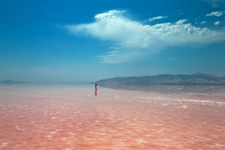 This picture taken on Friday, Aug. 26, 2016, shows an Iranian spending time in Urmia Lake near Urmia, North-western Iran. Hopes for survival of Urmia salt lake have been revived after more rains boosted a government program aimed at preserving the almost dried up water body. (AP Photo/Ebrahim Noroozi)