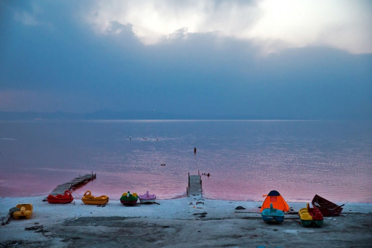 This picture taken on Thursday, Aug. 25, 2016, shows Iranians spending time in Urmia Lake near Urmia, North-western Iran. Hopes for survival of Urmia salt lake have been revived after more rains boosted a government program aimed at preserving the almost dried up water body. (AP Photo/Ebrahim Noroozi)