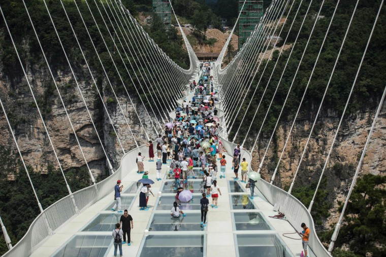 The world's highest and longest glass-bottomed bridge is seen above a valley in Zhangjiajie in China's Hunan Province on August 20, 2016. (FRED DUFOUR/AFP/Getty Images)
